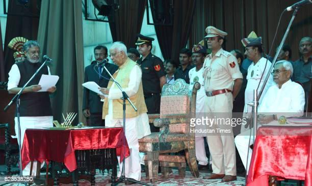 Bihar Chief Minister Nitish Kumar and Deputy Chief Minister Sushil Modi at Raj Bhawan on July 27 2017 in Patna India Nitish Kumar walked back into...