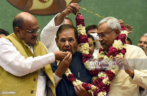 Bihar Chief Minister Nitish Kumar and newly elected JD National president being greeted by outgoing party president Sharad Yadav and National...