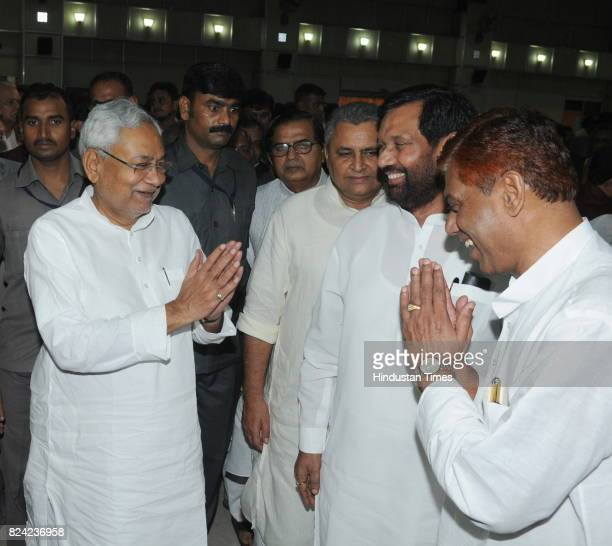 Bihar Chief Minister Nitish Kumar being wished by Union Minister Ram Vilas Paswan oath taking ceremony of ministers at Raj Bhawan on July 29 2017 in...