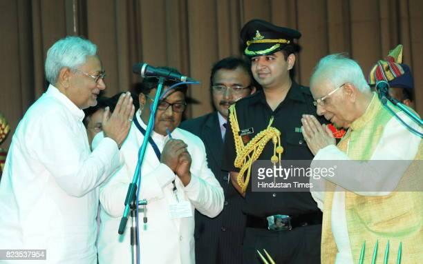 Bihar Chief Minister Nitish Kumar greets Bihar Governor Keshari Nath Tripathi after taking oath at Raj Bhawan on July 27 2017 in Patna India Nitish...