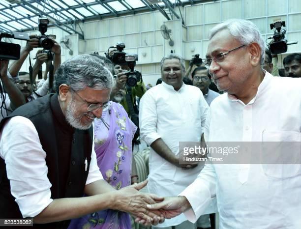 Bihar Chief Minister Nitish Kumar greets BJP leader Sushil Modi before oath taking ceremony at Raj Bhawan on July 27 2017 in Patna India Nitish Kumar...