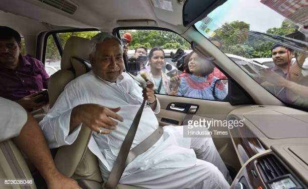 Bihar Chief Minister Nitish Kumar leaves in his car after swearing in ceremony of the new president Ram Nath Kovind at Parliament House on July 25...