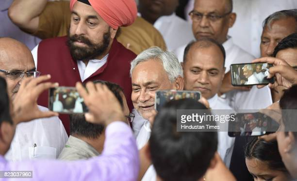 Bihar Chief Minister Nitish Kumar leaving after swearing in ceremony of the new president Ram Nath Kovind at Parliament House on July 25 2017 in New...