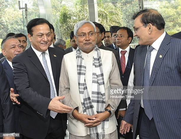 Bihar Chief Minister Nitish Kumar welcomed by Managing Director and CEO Yes Bank Rana Kapoor as Director Videocon Industries Limited Rajkumar Dhoot...