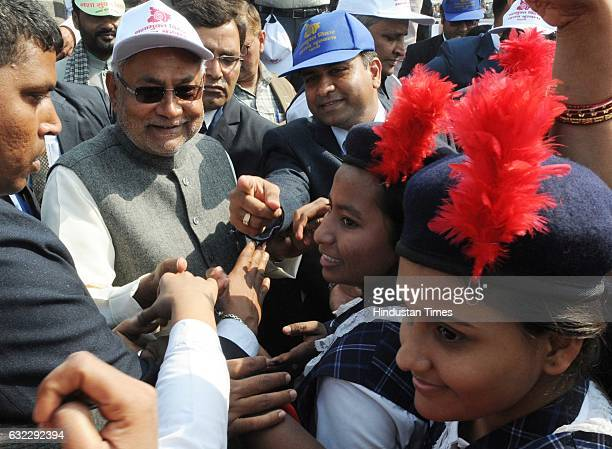 Bihar Chief Minister Nitish Kumar with children making a massive human chain against alcoholism and other addictions at historical Gandhi Maidan on...