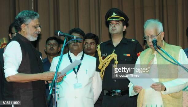 Bihar Governor Keshari Nath Tripathi administers oath to BJP leader Sushil Modi as Bihar Deputy Chief Minister at Raj Bhawan on July 27 2017 in Patna...