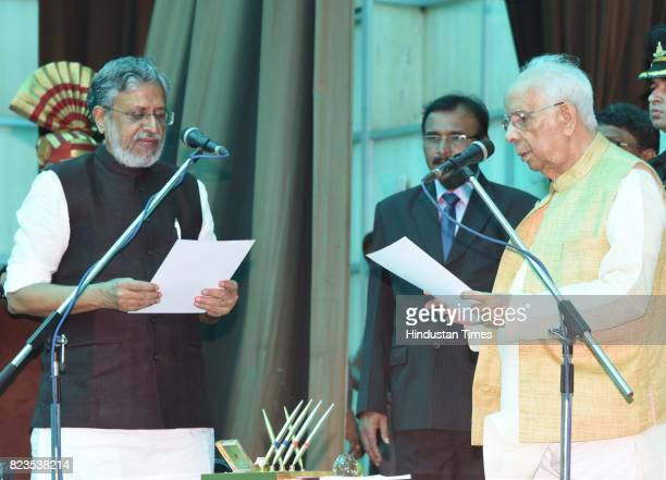 Bihar Governor Keshari Nath Tripathi administers oath to BJP leader Sushil Modi as Bihar Deputy Chief Minister at Raj Bhawan on July 27 2017 in Patna...