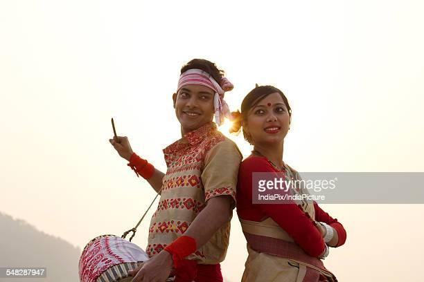 Bihu dancers standing back to back