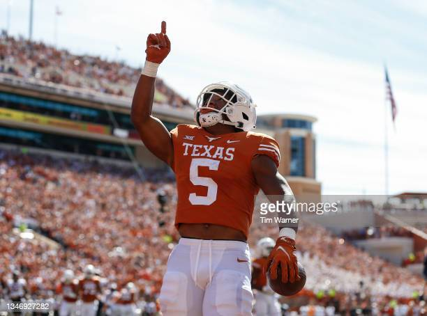 Bijan Robinson of the Texas Longhorns reacts after a second quarter touchdown against the Oklahoma State Cowboys at Darrell K Royal-Texas Memorial...