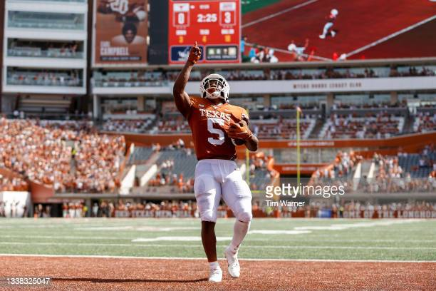 Bijan Robinson of the Texas Longhorns reacts after a touchdown in the first quarter against the Louisiana Ragin' Cajuns at Darrell K Royal-Texas...