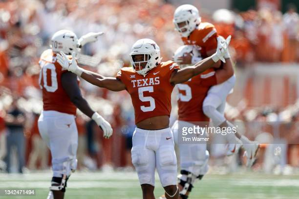 Bijan Robinson of the Texas Longhorns reacts after a touchdown pass thrown by Casey Thompson in the second quarter against the Texas Tech Red Raiders...
