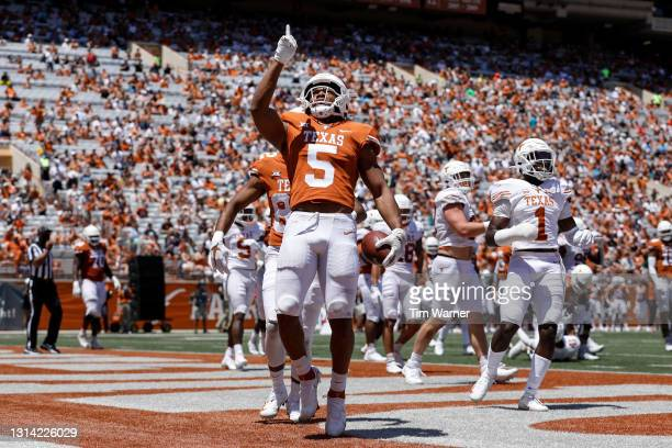 Bijan Robinson of the Texas Longhorns rushes for a touchdown in the first half during the Texas Football Orange-White Spring Game at Darrell K...