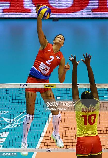 Bikatal of Cameroon in action against Brakocevic of Serbia during the 2014 FIVB Volleyball Women's World Championship Group B volleyball match...