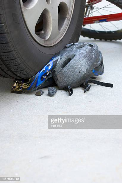 Bike Accident Helmet Crushed By Car Tire Vertical