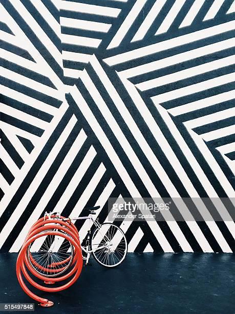 Bike against black and white wall, Miami, USA