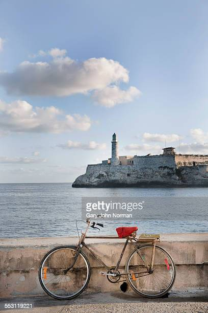 Bike against wall at entrance to Havana Bay.