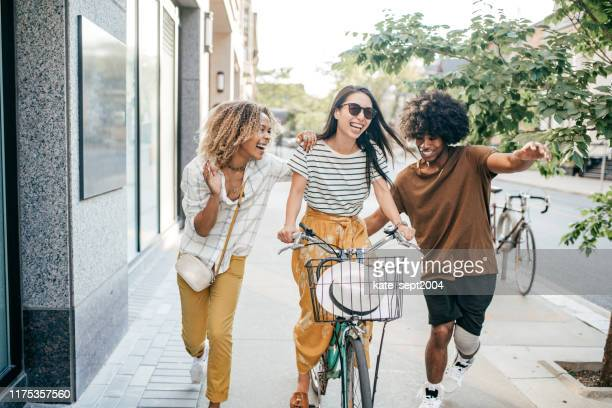 bike and friends - millennial generation stock pictures, royalty-free photos & images