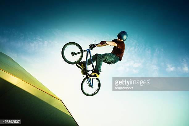 bmx bike artist jump on sport ramp - bmx cycling stock pictures, royalty-free photos & images