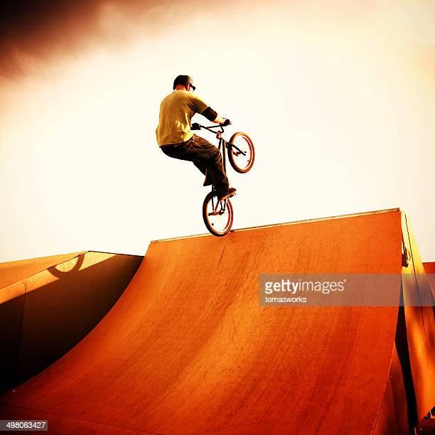 BMX bike artist jump on sport ramp