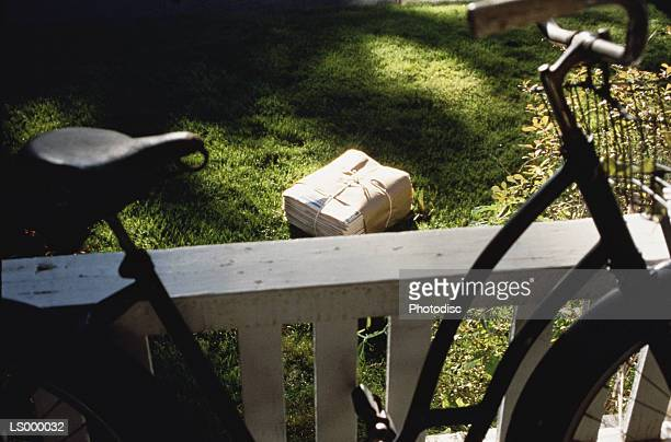 Bike, Bundle of Newspapers, and Yard