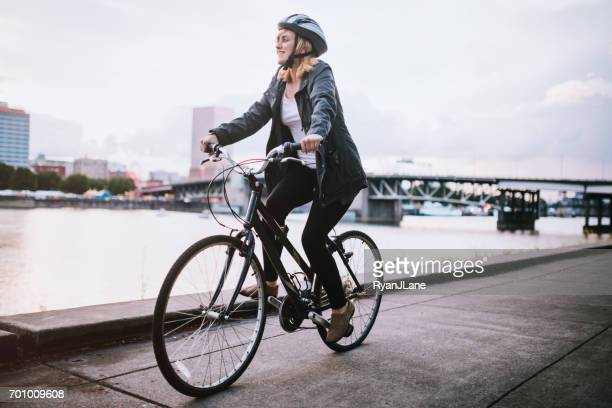 bike commuter in city of portland - burnside bridge portland stock photos and pictures