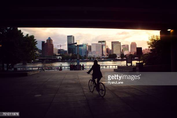 bike commuter in city of portland - portland oregon stock photos and pictures