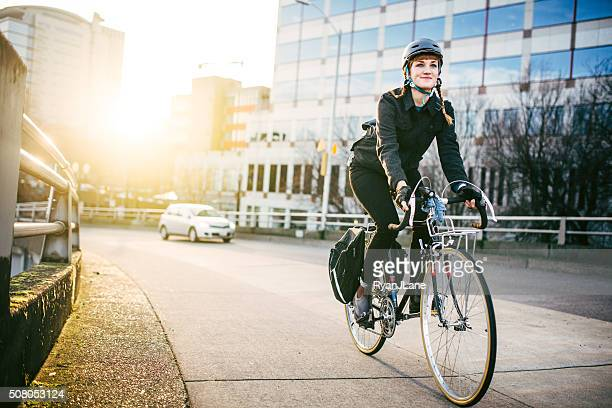bike commuter in portland oregon - sports helmet stock pictures, royalty-free photos & images