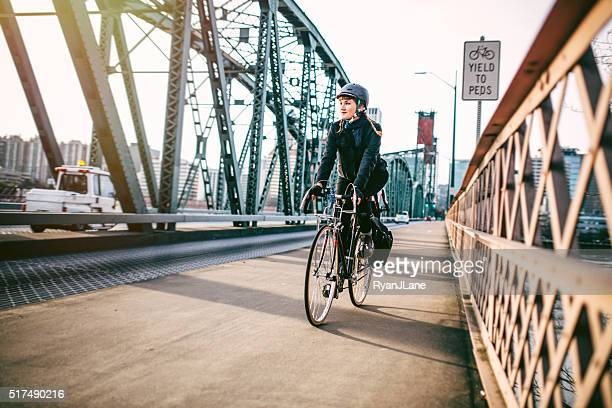 bike commuter in portland oregon - cycling helmet stock photos and pictures