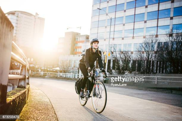 bike commuter in portland oregon - riding stock pictures, royalty-free photos & images