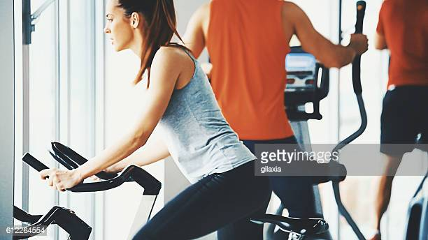 Bike exercising in a gym.