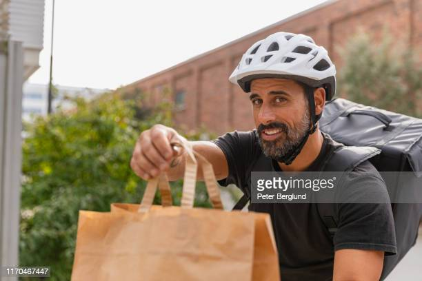 bike food delivery - ringing doorbell stock pictures, royalty-free photos & images