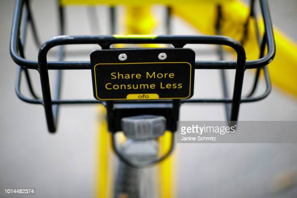 A bike from the bikesharing provider Ofo with a sign on the bike basket with the inscription 'Share More Consume Less' on August 08 2018 in Berlin...