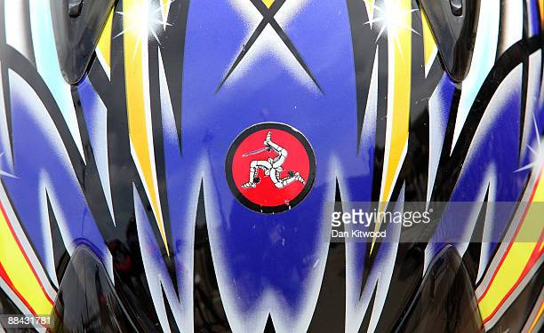A bike helmet with an image of the Isle of Man's Coat of Arms the 'Three Legs' lays on the promenade on June 7 2009 in Peel Isle Of Man The annual TT...