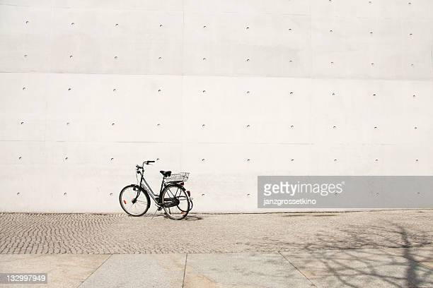 Bike in front of grey wall