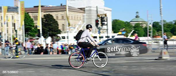 Bike in motion, panning blur in traffic