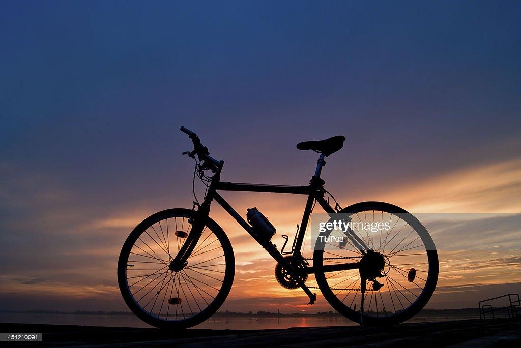 Bike in sunset : Stock Photo