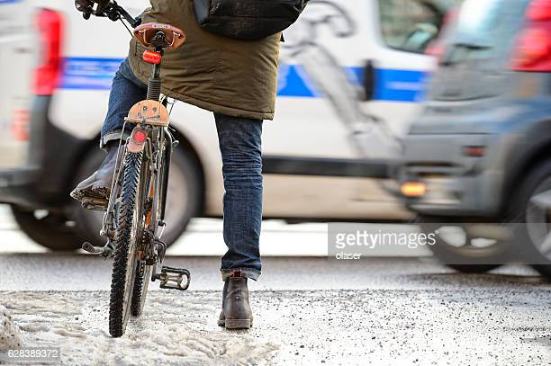 bike in traffic, winter - commuter stock pictures, royalty-free photos & images
