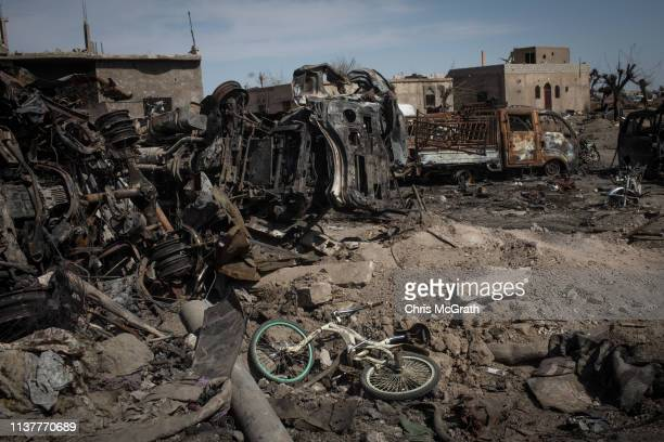 Bike is seen amongst destroyed vehicles in the final ISIL encampment on March 23, 2019 in Baghouz, Syria. The Kurdish-led and American-backed Syrian...
