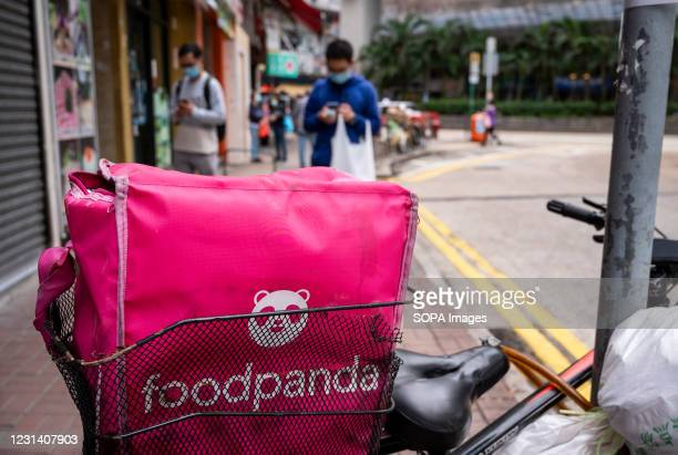 Bike is seen parked on the street carrying an insulated food bag from the delivery take out food company, Foodpanda in Hong Kong.