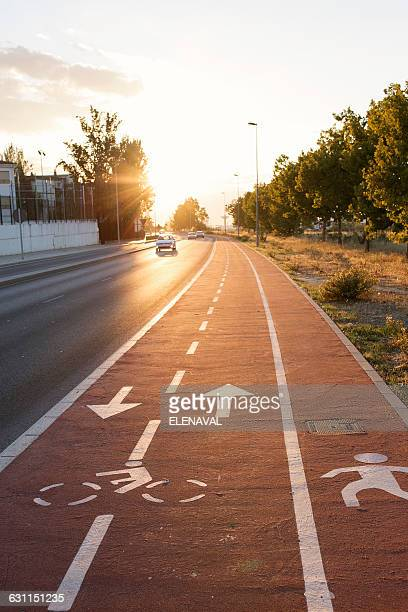 Bike lane, pedestrian path and road in city, Granada, Andalucia, Spain