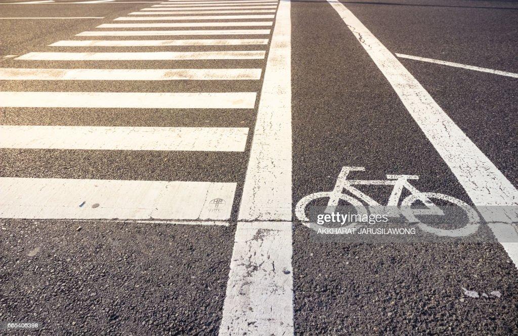 Bike Lane Symbol With Crosswalk On Asphalt Street Stock Photo
