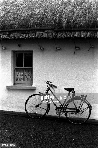 bike leaning on cottage, donegal, ireland - county donegal stock photos and pictures
