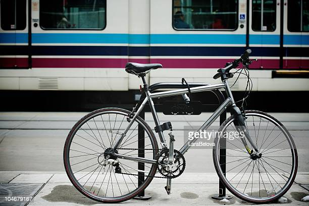 bike left at tram station - calgary stock pictures, royalty-free photos & images