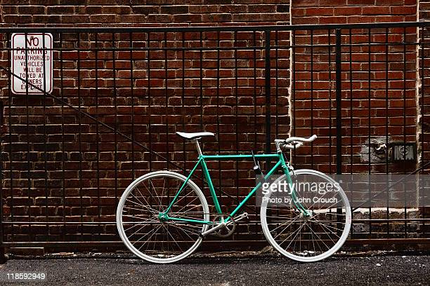Bike locked to fence