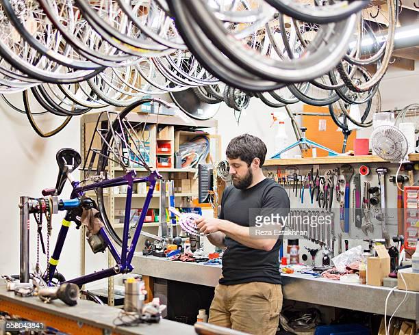 Bike mechanic fixes bike gears