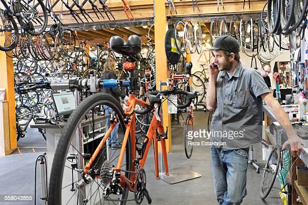 Bike mechanic on cell phone