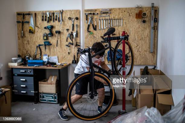 A bike mechanic works in customized bikes store 8bar on August 03 2020 in Berlin Germany As COVID19 discourages the use of buses and subways demand...