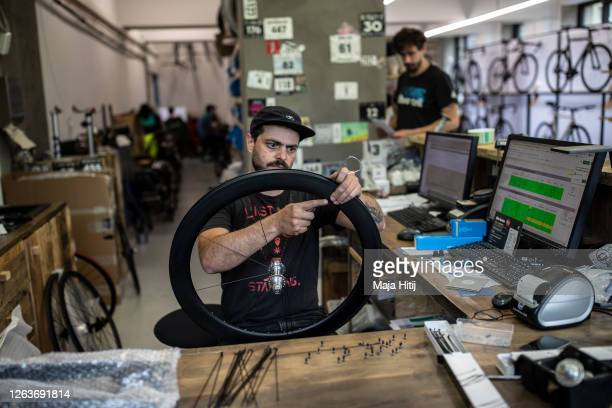 Bike mechanics work in customized bikes store 8bar on August 03 2020 in Berlin Germany As COVID19 discourages the use of buses and subways demand on...