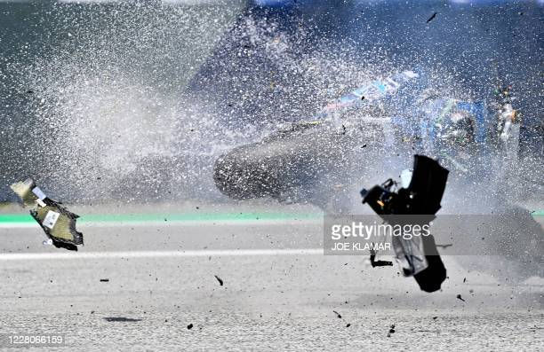 Bike of Italtrans Racing Team Italian rider Enea Bastianini is hit by another bike during a crash during the Moto2 Austrian Grand Prix at Red Bull...