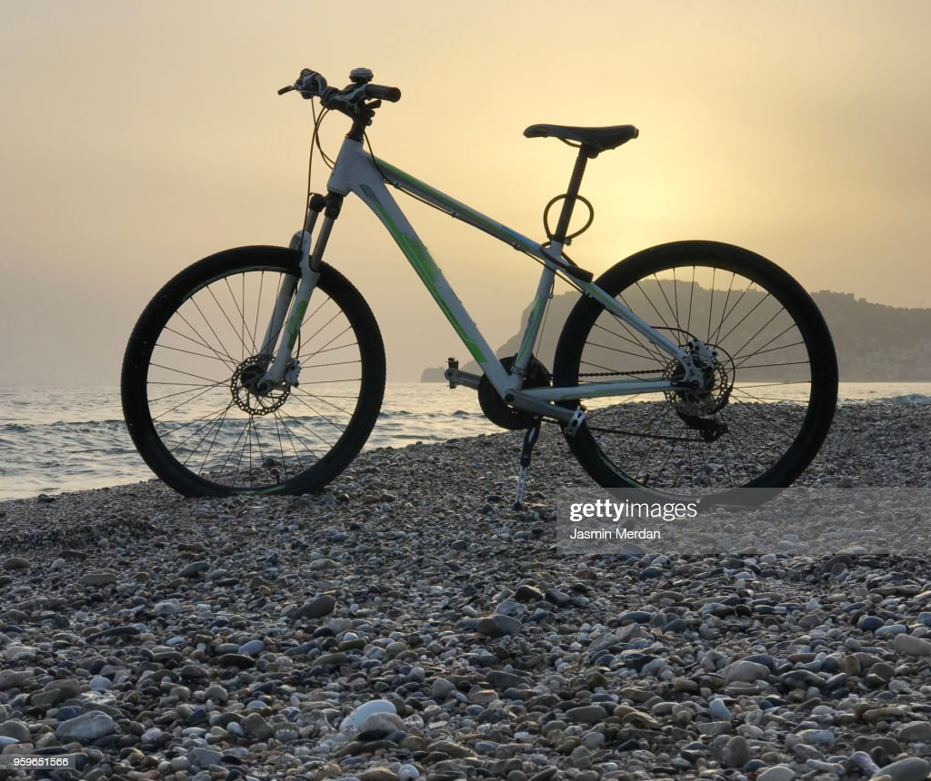Bike on sunset beach : Stock Photo